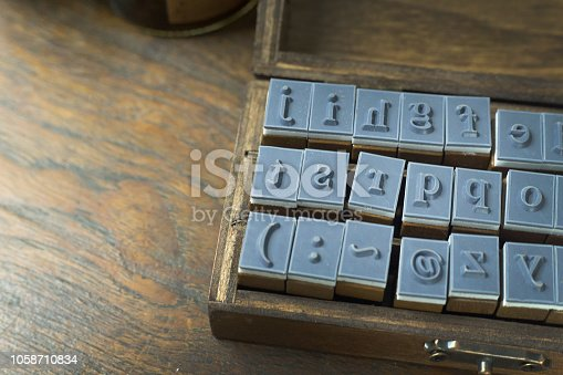 istock wood stamp alphabet close up image for background. 1058710834