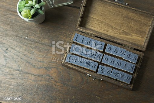 istock wood stamp alphabet close up image for background. 1058710840
