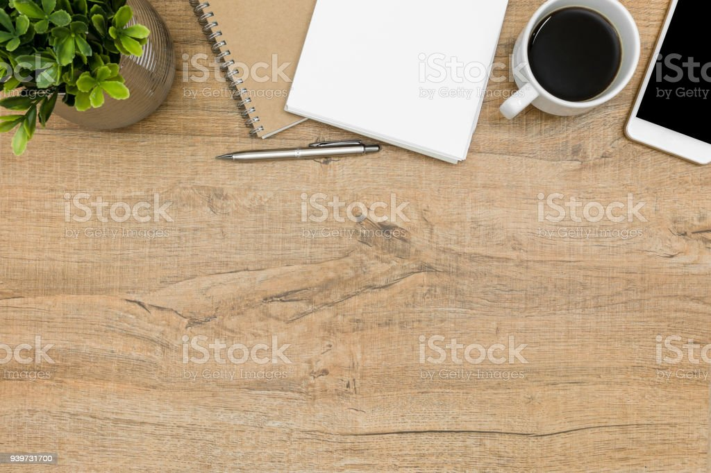 https://media.istockphoto.com/photos/wood-student-desk-with-notebook-pen-coffee-and-supplies-top-view-with-picture-id939731700
