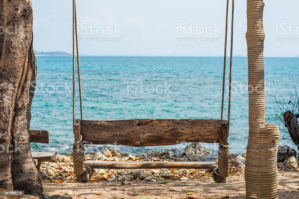 Wood swing on the beach stock photo