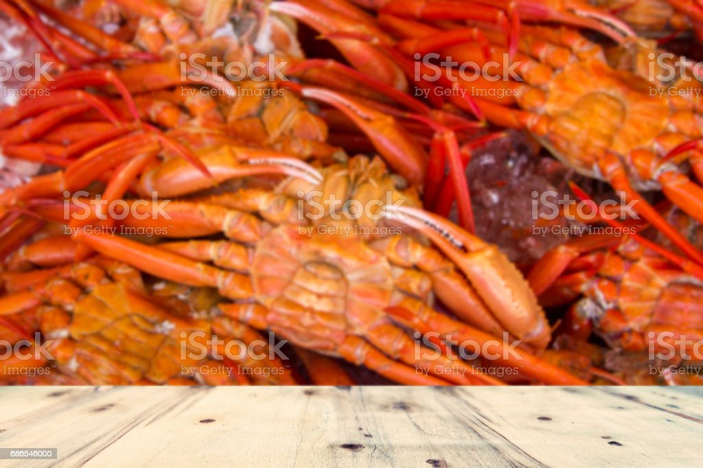 wood table and blur image of king crabs packed on ice in the market in sapporo zbiór zdjęć royalty-free