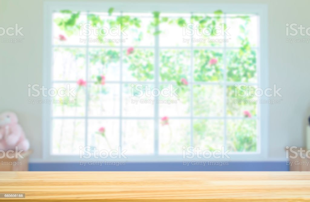 Wood table and interior room blurred background. royalty-free stock photo