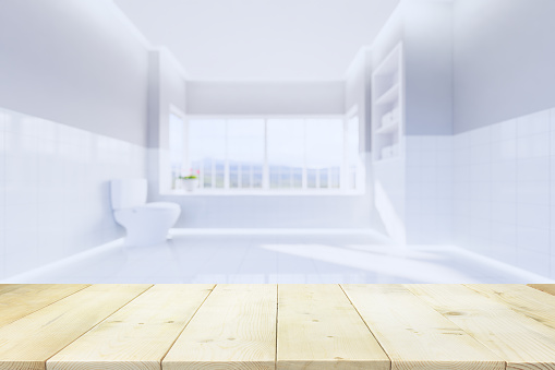819534860 istock photo wood table and toilet background 1219302488