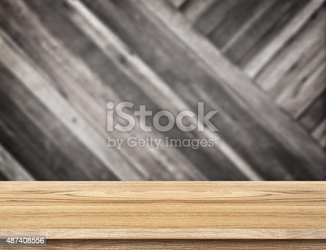 593305530istockphoto wood table at blurred dark tropical plank wooden wall 487408556