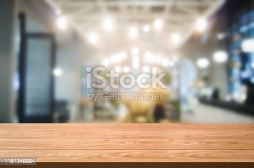 924418708 istock photo Wood table in blurry background of modern restaurant. 1181346664