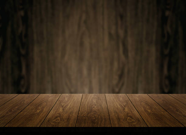 wood table in front of wood wall blur background. - kitchen counter imagens e fotografias de stock