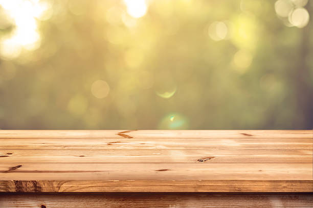wood table in park - table stock photos and pictures