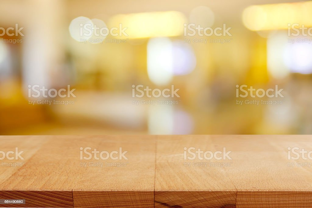 Wood table on blur background for advertising display