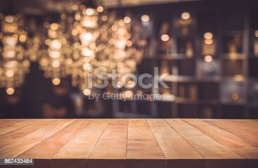864907996istockphoto Wood table on blur cafe (restaurant) background 862433484