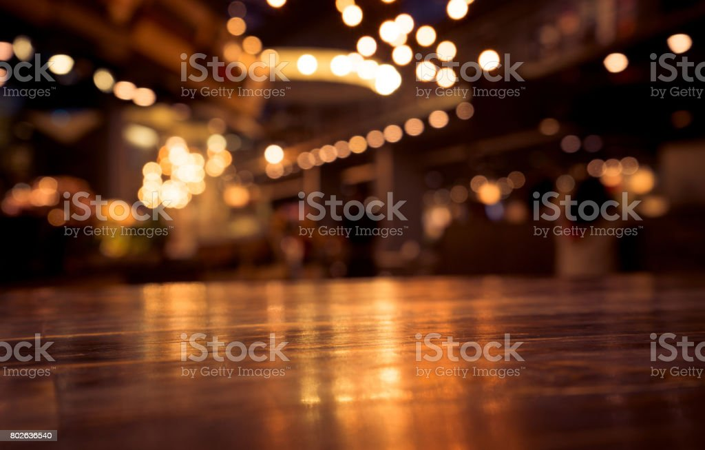 Wood table on blur cafe (bar) with light background stock photo