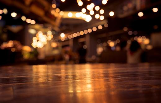 Wood Table On Blur Cafe With Light Background - zdjęcia stockowe i więcej obrazów Bar kawowy
