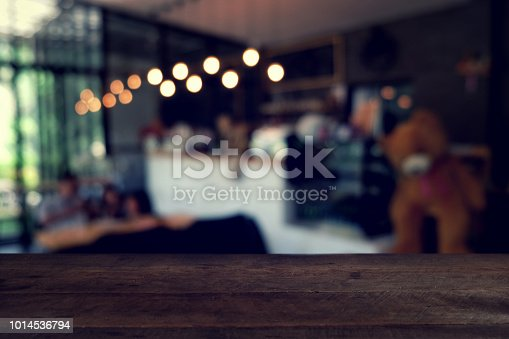 istock wood table on blur of cafe, coffee shop, bar, resturant, background - can used for display or montage your products 1014536794