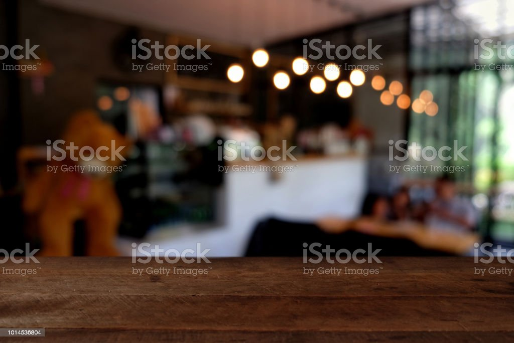 Wood Table On Blur Of Cafe Coffee Shop Bar Resturant Background Can Used For Display Or Montage Your Products Stock Photo Download Image Now Istock