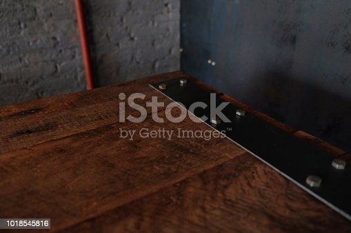 istock wood table on blur of cafe, coffee shop, bar, resturant, background - can used for display or montage your products 1018545816