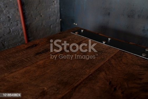 istock wood table on blur of cafe, coffee shop, bar, resturant, background - can used for display or montage your products 1018545824