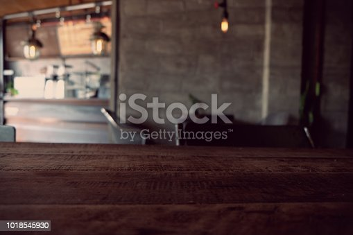 istock wood table on blur of cafe, coffee shop, bar, resturant, background - can used for display or montage your products 1018545930