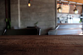 istock wood table on blur of cafe, coffee shop, bar, resturant, background - can used for display or montage your products 1018545964