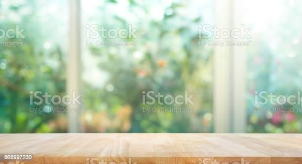 Wood table on blur of window with garden flower background picture id868997230?b=1&k=6&m=868997230&s=612x612&h=bhmqcm 1fbxn peqzmwljgxbv ekzk7tx1f00qcrzyw=