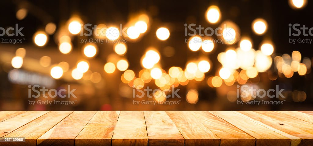 Wood table on blurred cafe restaurant with light background stock photo