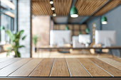 istock Wood Table On Blurred of Office Building. 1266428142