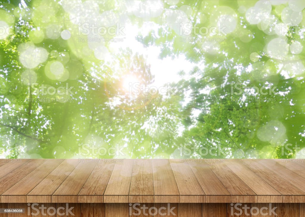Wood table perspective with green leaf stock photo