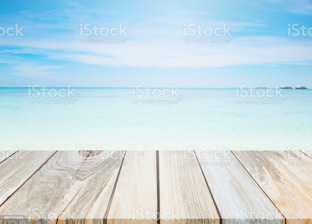 Wood Table Top And Blur Background Of The Beach stock photo