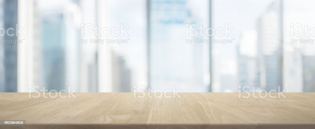Wood table top and blur glass window wall building banner background royalty-free stock photo