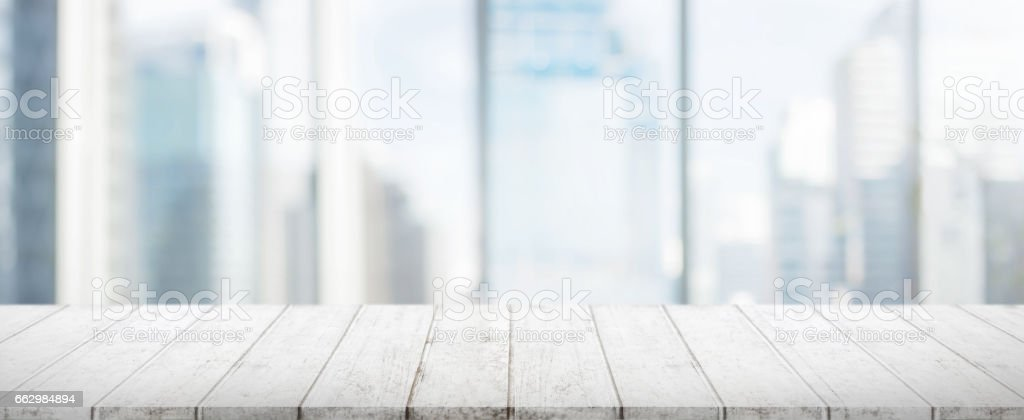 Wood table top and blur glass window wall building banner background stock photo
