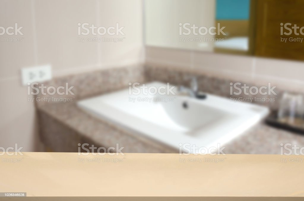wood top table and Abstract Blurred sink modern in the bathroom. Can...