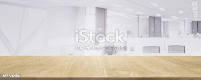 istock Wood table top and blurred bokeh office interior space background - can used for display or montage your products. 867720456