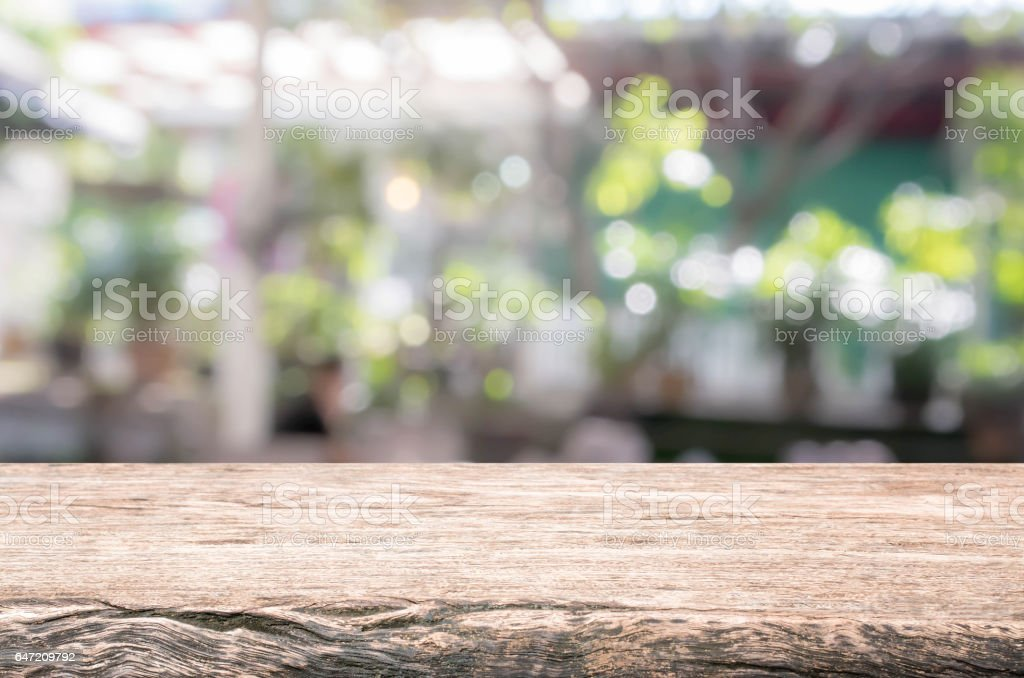 Wood table top and blurred restaurant exterior background. royalty-free stock photo
