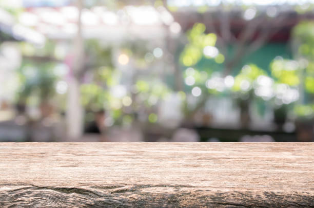Wood table top and blurred restaurant exterior background. stock photo