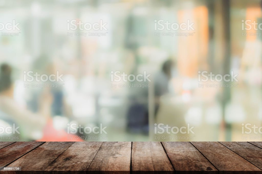 Wood table top and blurred restaurant interior background - can used for display or montage your products. stock photo