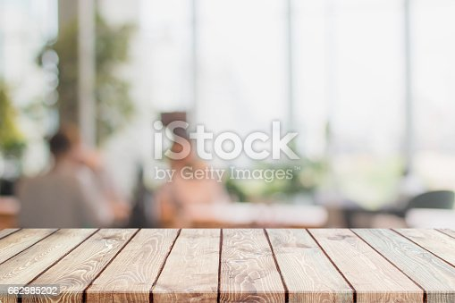 istock Wood table top and blurred restaurant interior background 662985202