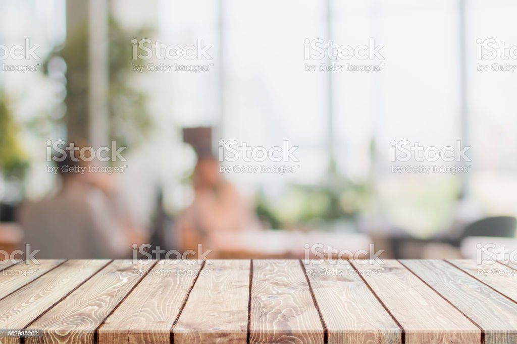 Wood table top and blurred restaurant interior background stock photo