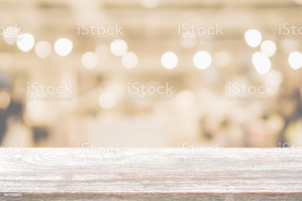 Wood table top and blurred restaurant interior background with vintage filter. stock photo