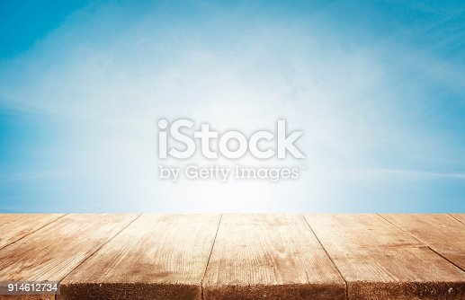 istock Wood Table Top Background, Empty Wooden Desk on Blue Sky, Tables Planks Shelf 914612734
