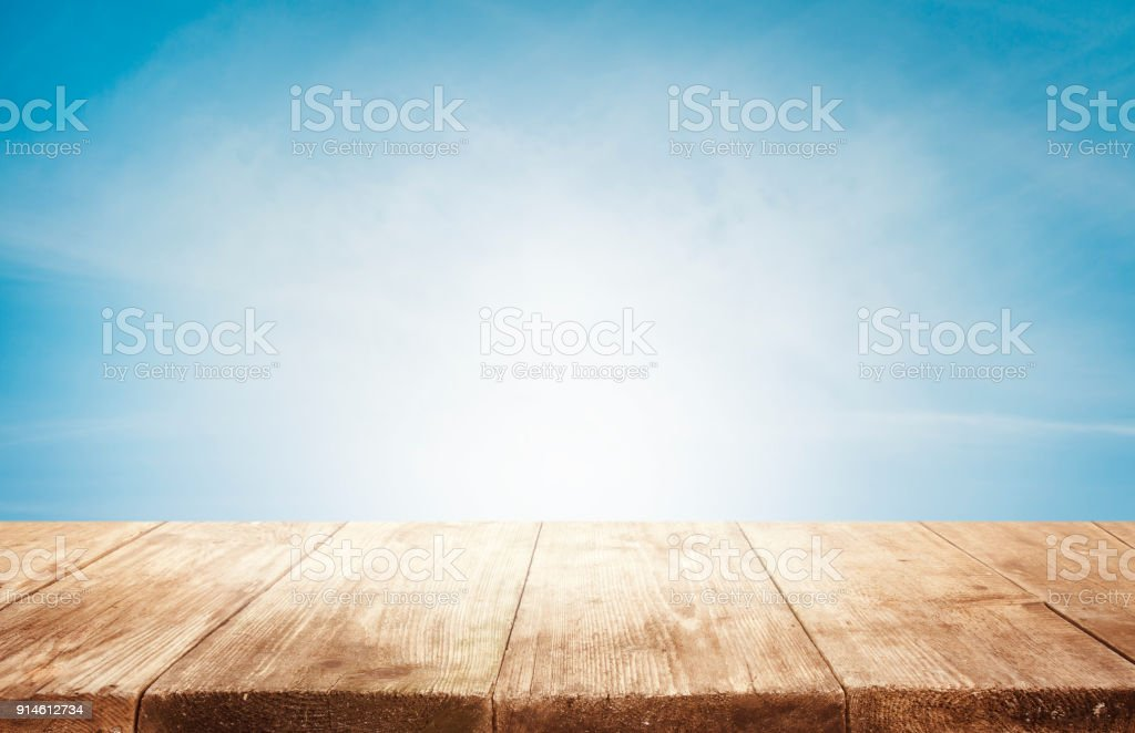 Wood Table Top Background, Empty Wooden Desk on Blue Sky, Tables Planks Shelf stock photo