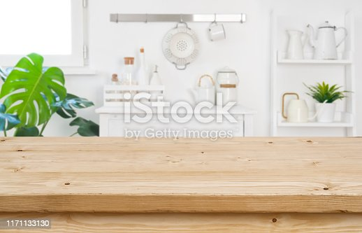 Wood table top for product display on blur kitchen background