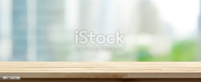 Wood table top on abstract blurred cityscape banner background - can be used for display or montage your products