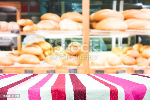 886308526 istock photo Wood table top on bakery shop background. 890011228