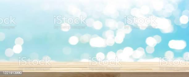 Wood table top on blue summer sparking sea water bokeh banner picture id1221913990?b=1&k=6&m=1221913990&s=612x612&h=bwi7c91x1gnndlm6ue9q8ggxsbmzh5lzk6eno6ta0 o=