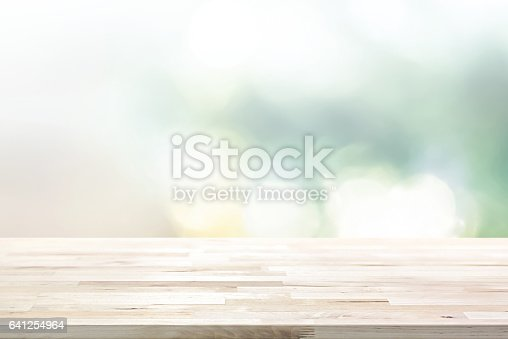 istock Wood table top on  blur abstract white green bokeh background 641254964