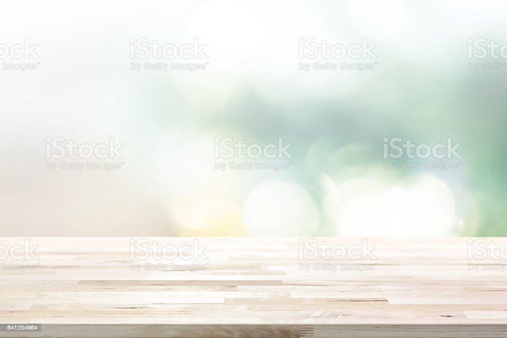Wood table top on  blur abstract white green bokeh background stock photo