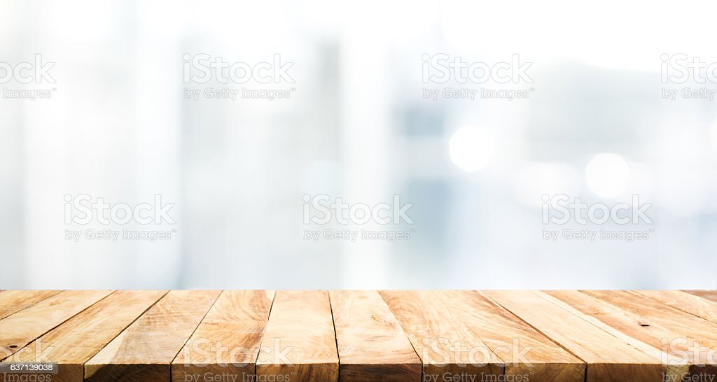 Wood Table Top On Blur Glass Window Wall Background. Royalty Free Stock  Photo