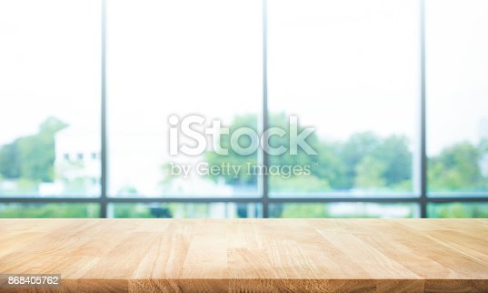 680878382istockphoto Wood table top on blur green garden from window view. 868405762