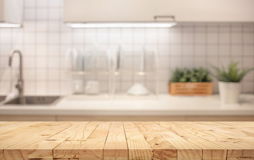 木桌頂部模糊的廚房櫃檯背景 照片檔及更多 乾淨 照片