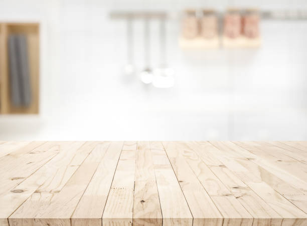 Wood table top on blur kitchen counter (room)background stock photo