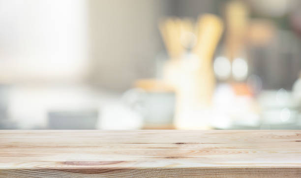 Wood table top on blur kitchen counter background stock photo