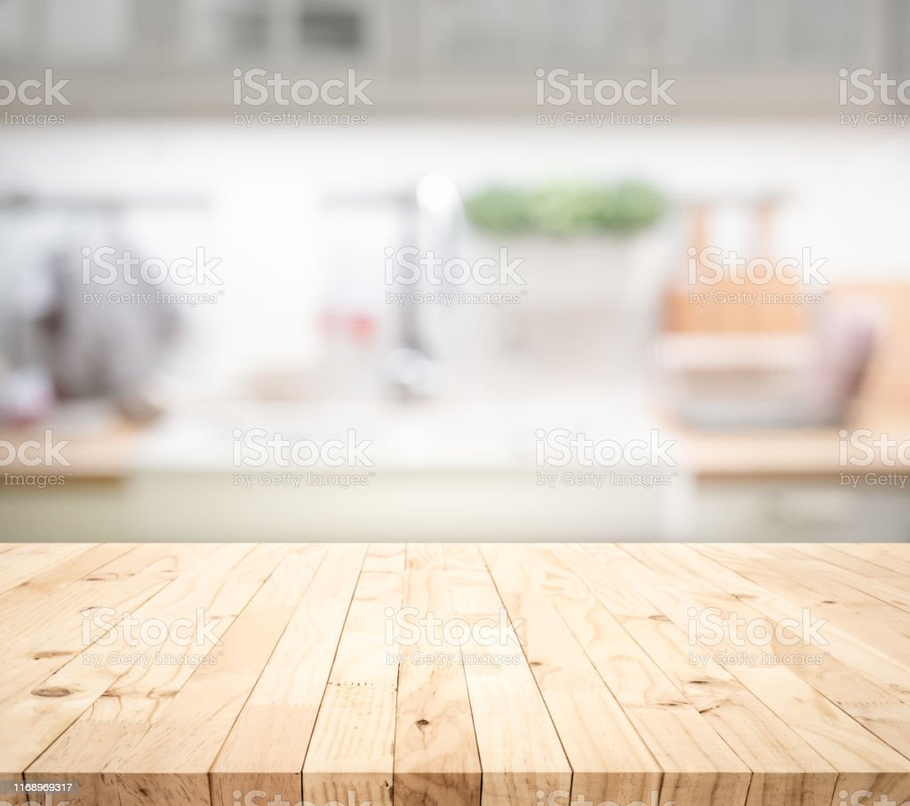 Wood Table Top On Blur Kitchen Counter Backgroundfor Montage ...
